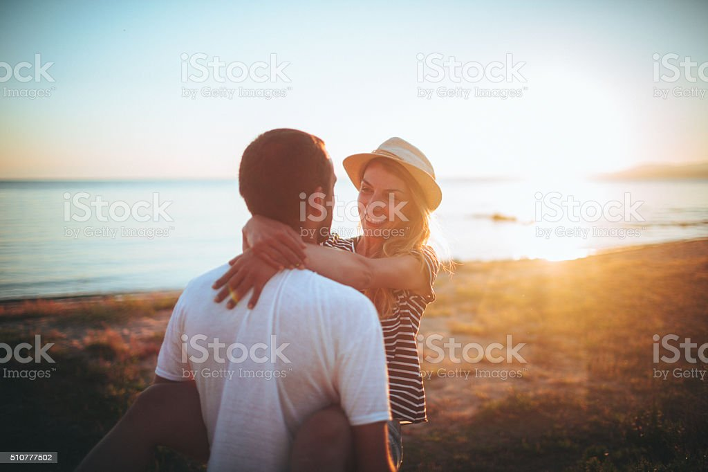 Loving couple at the beach stock photo