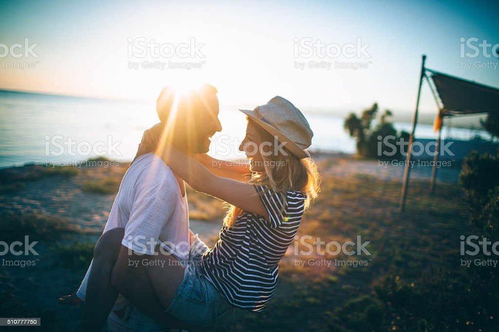 Loving couple at the beach stock photo