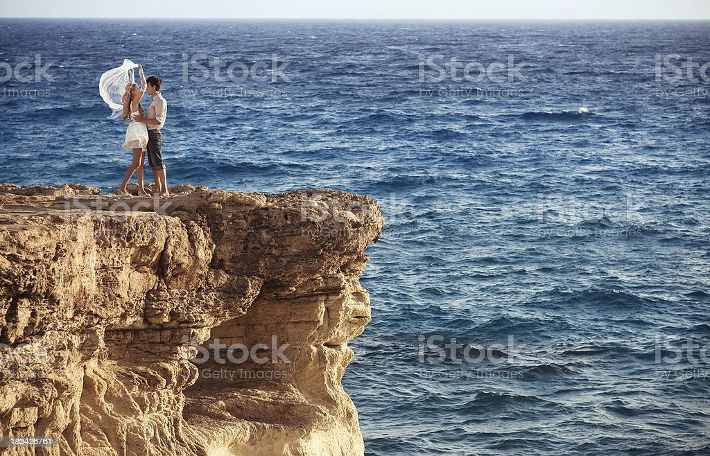 Loving couple at the end of sea cliff royalty-free stock photo