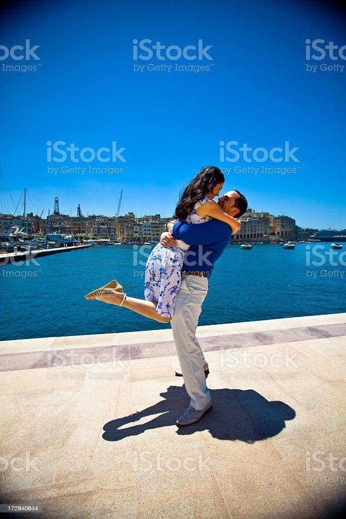 Loving couple by the bay royalty-free stock photo
