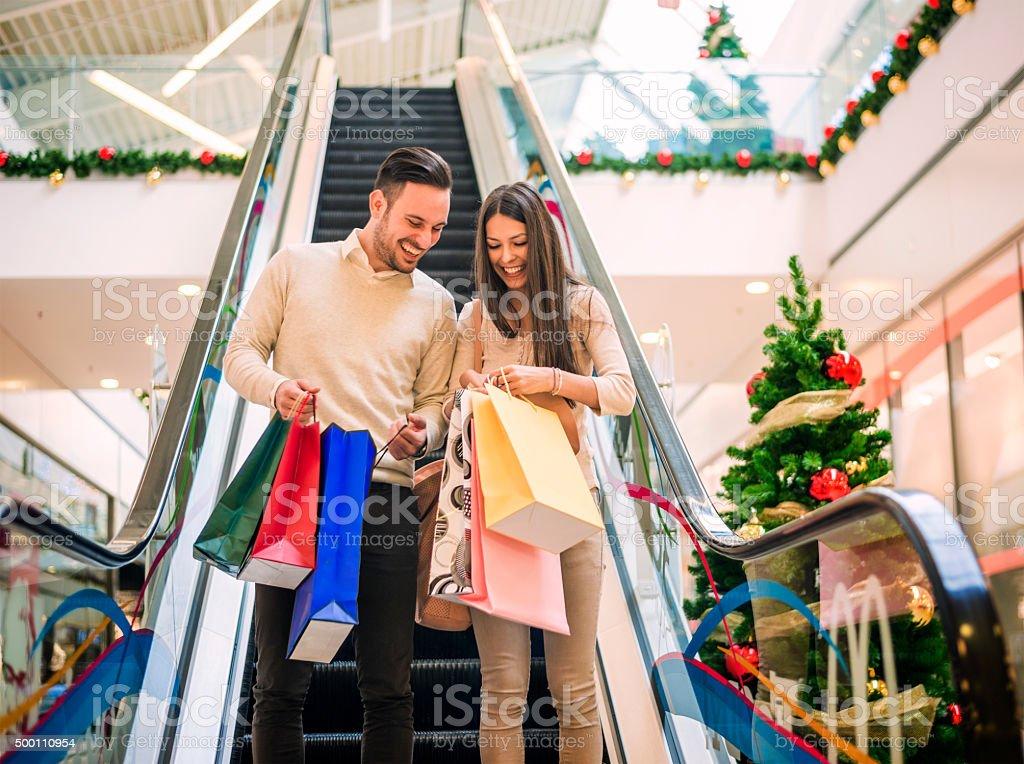 Loving couple doing Christmas shopping together stock photo
