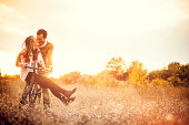 Loving couple driving a bicycle