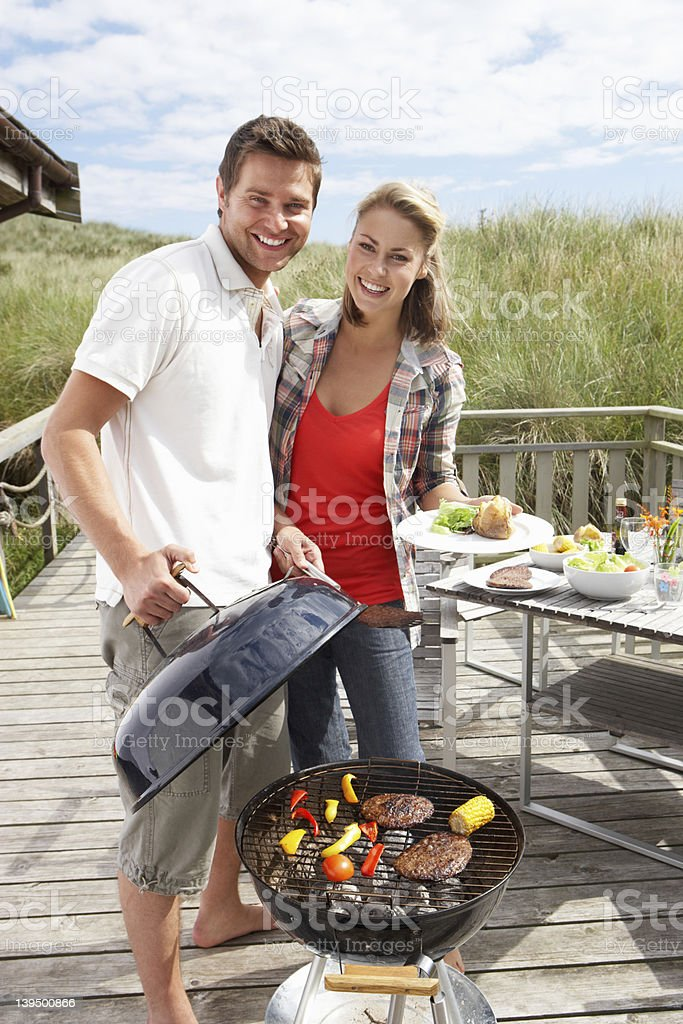 Loving couple enjoying barbecue in the open air royalty-free stock photo