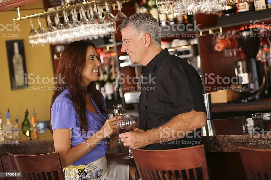 Loving Couple Enjoying Drinks In Restaurant Bar royalty-free stock photo