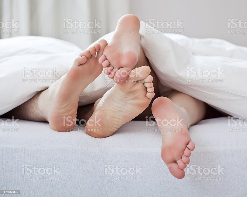 Loving couple feet stock photo