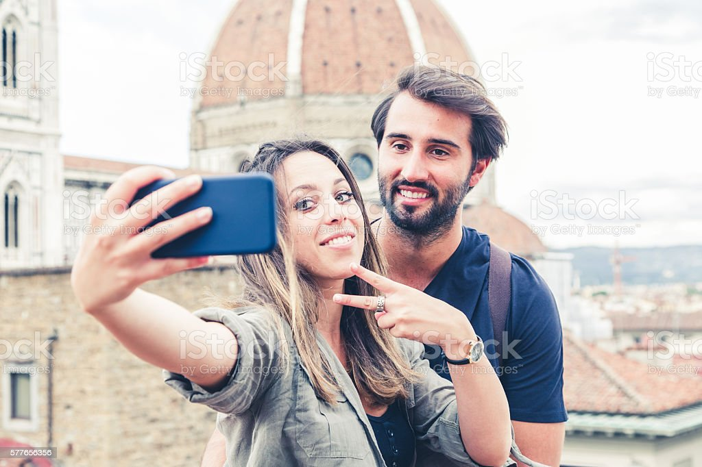 Loving couple having selfie in front of the Florence Cathedral stock photo