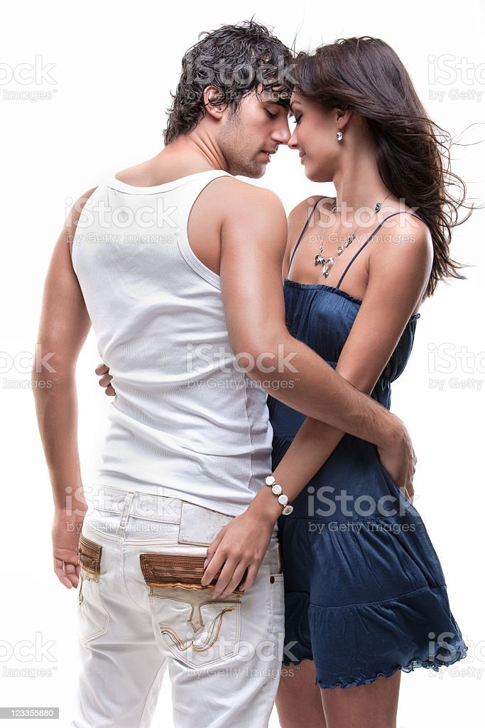 Loving couple holding each other posing in front of camera royalty-free stock photo
