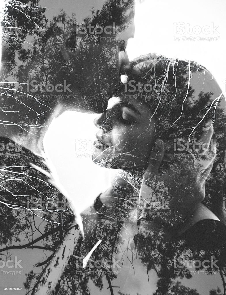 Loving couple image with tree branches in photgraphic effect stock photo