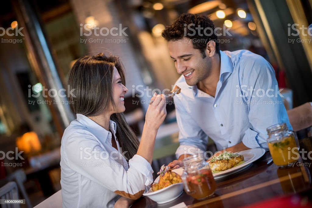 Loving couple in a romantic dinner stock photo
