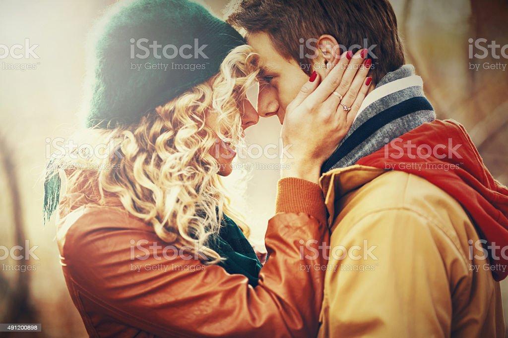 Loving couple in park. stock photo