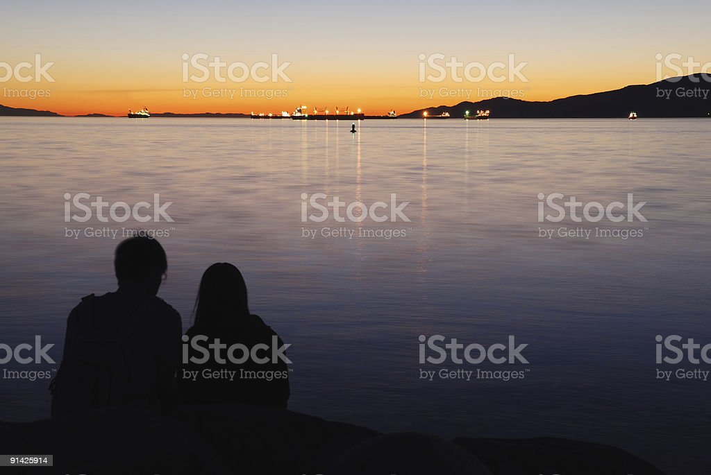 loving couple in sunset royalty-free stock photo