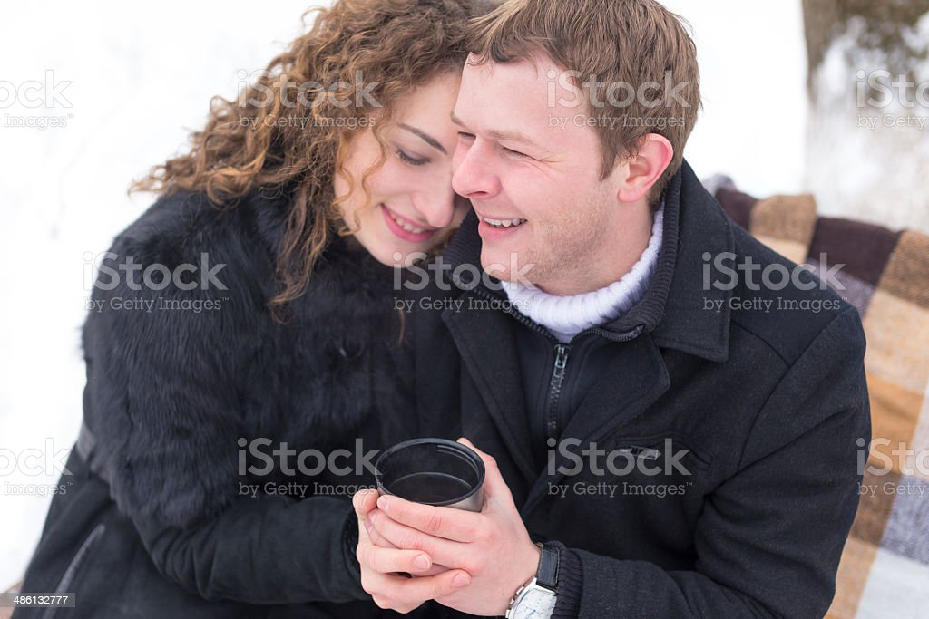 loving couple in the winter park royalty-free stock photo