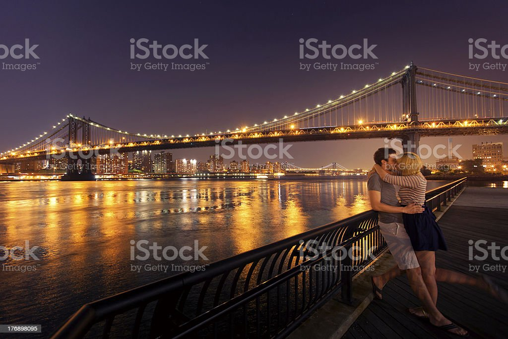 Loving couple kissing in New York City royalty-free stock photo