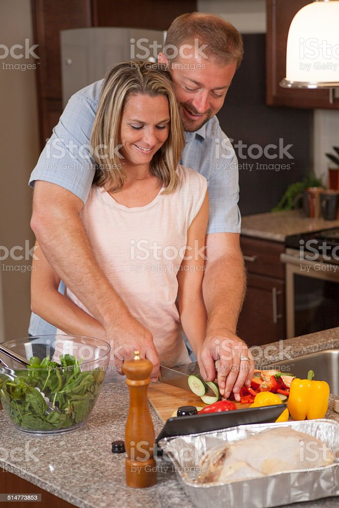 Loving couple makes dinner together stock photo