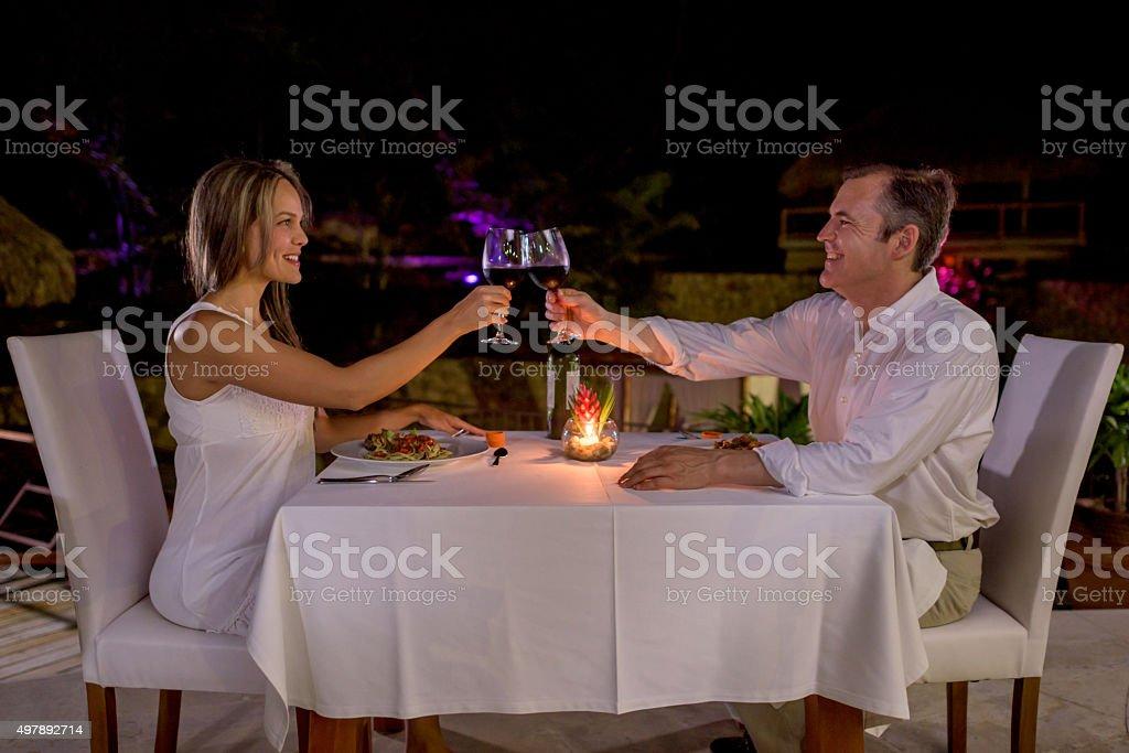 Loving couple making a toast stock photo
