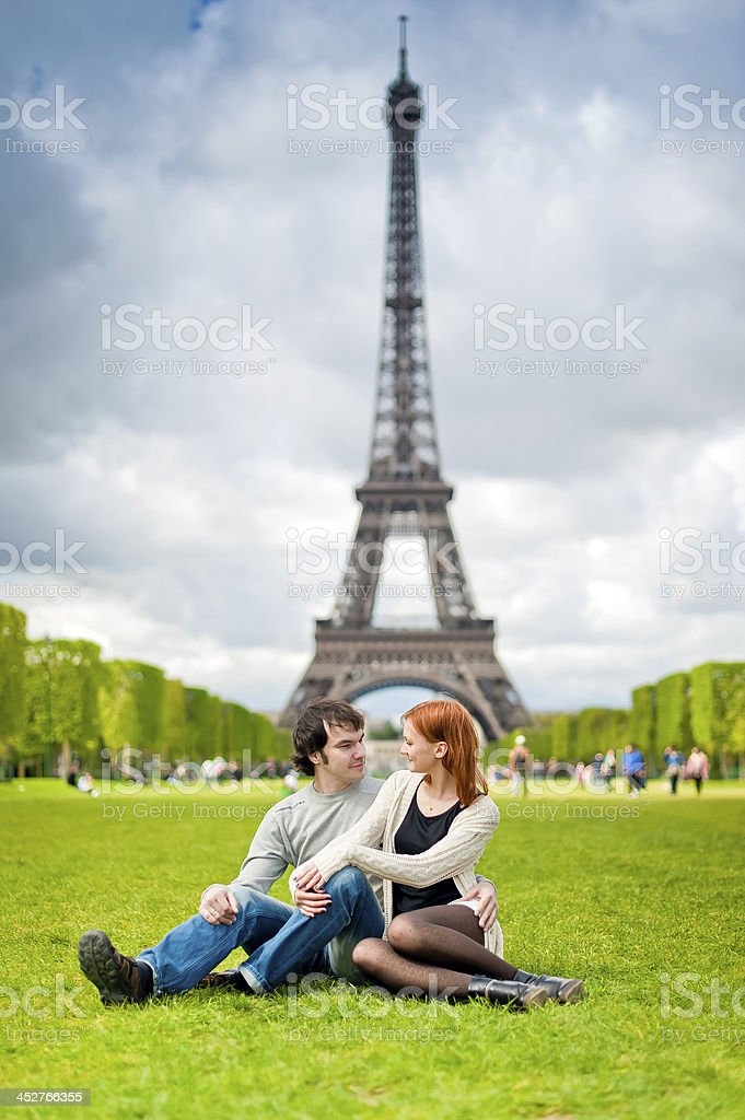 Loving couple near the Eiffel Tower in Paris royalty-free stock photo