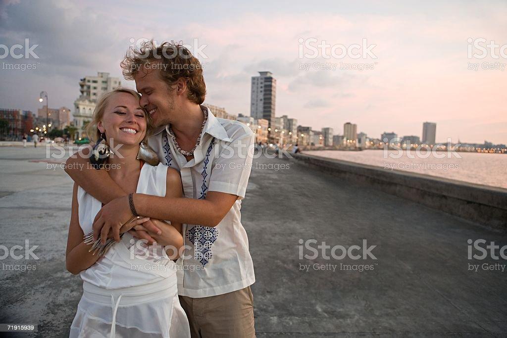 Loving couple on coastal boulevard stock photo
