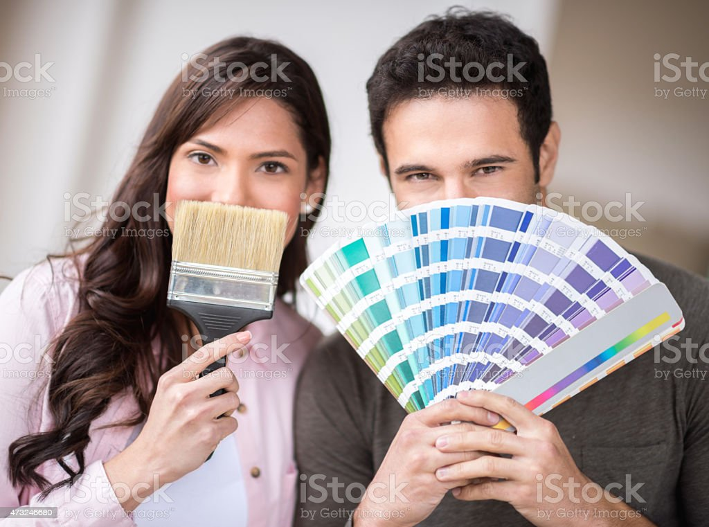 Loving couple painting their house stock photo