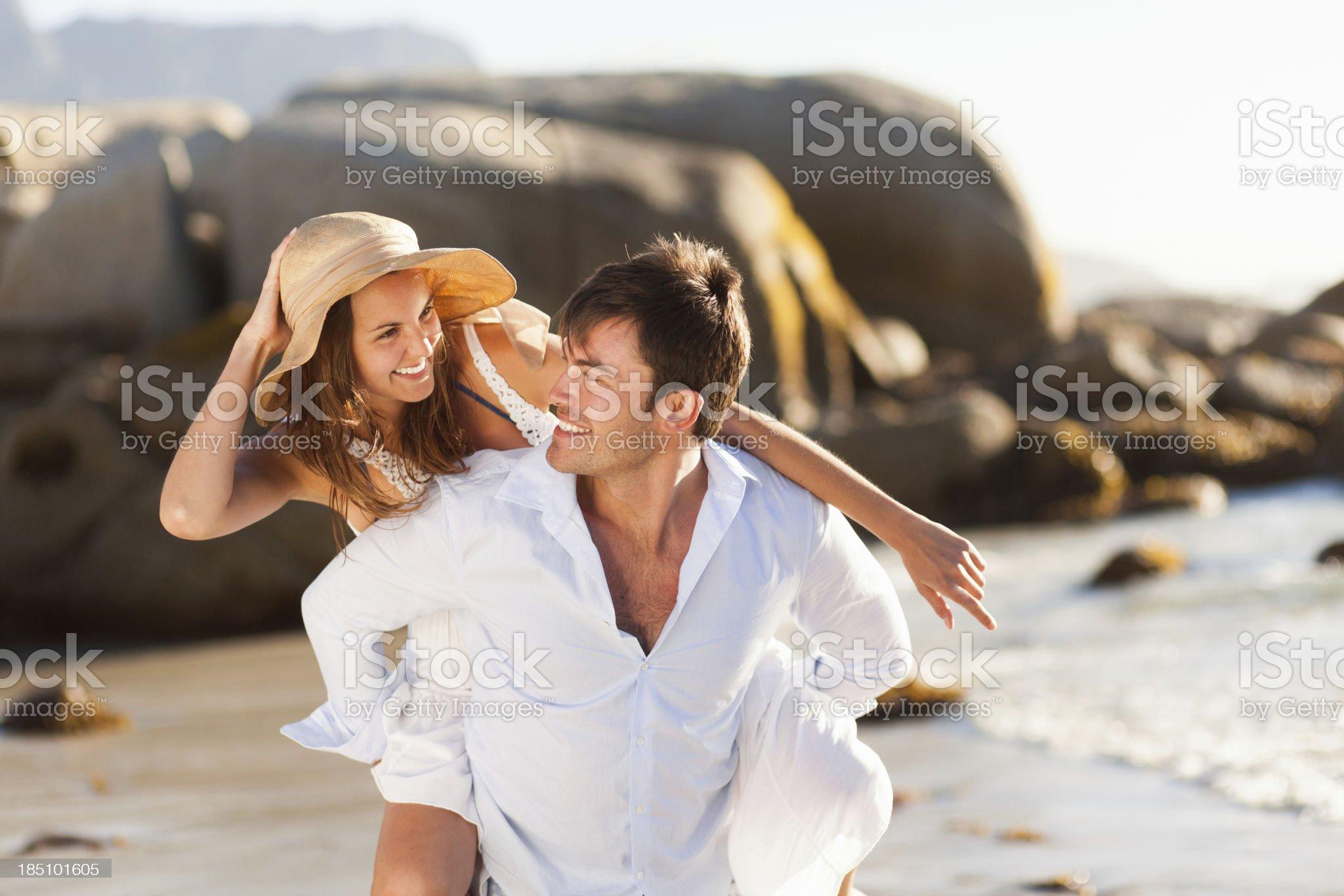 Loving Couple Piggybacking Together royalty-free stock photo