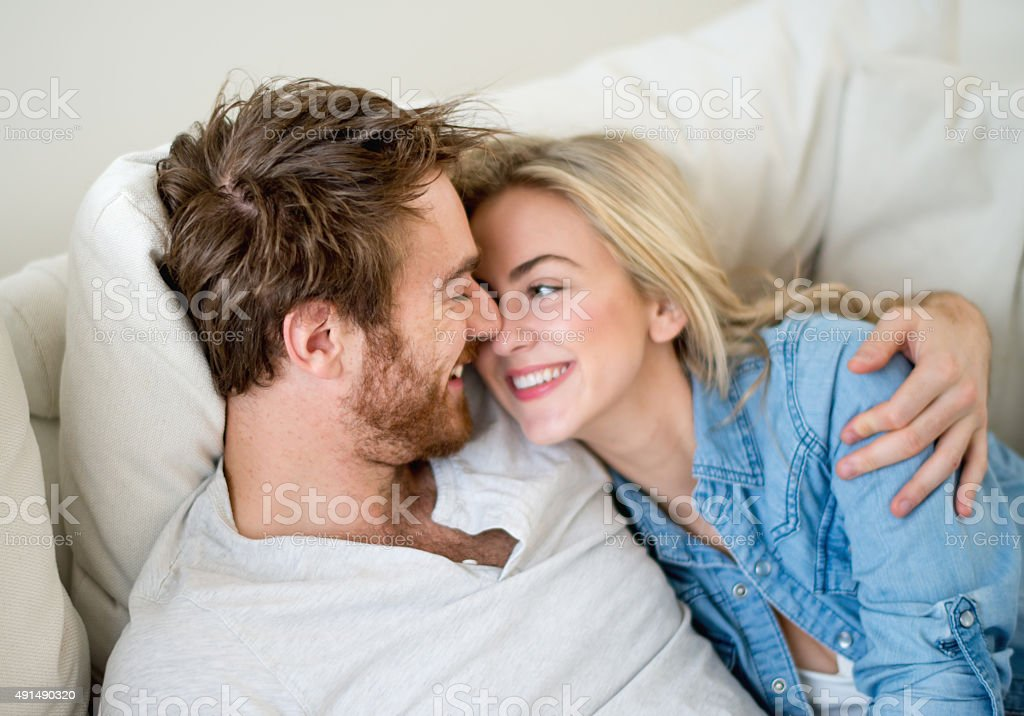 Loving couple relaxing at home stock photo