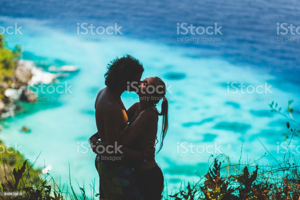 Loving couple relaxing on tropical island, enjoying holidays at Similans. View of bay with turquoise water stock photo