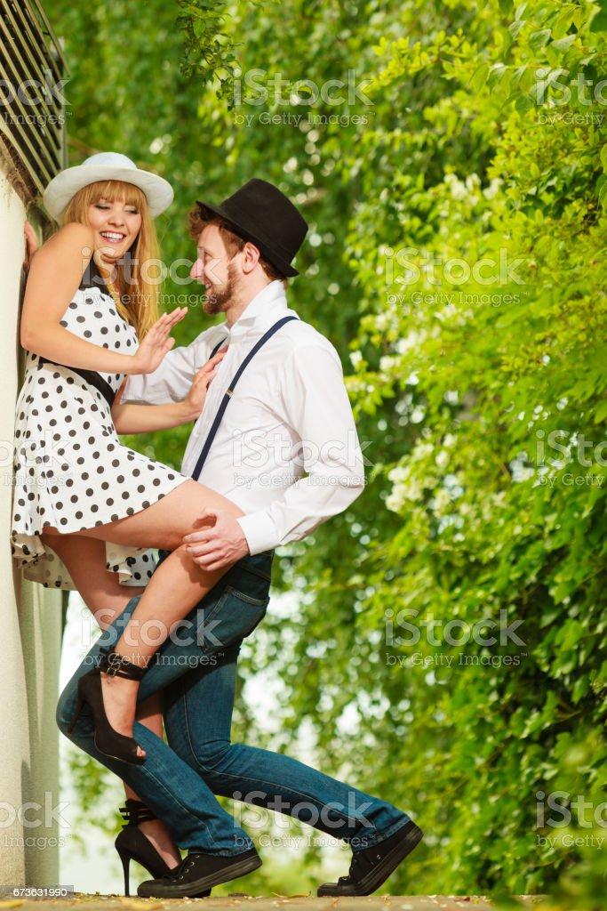 Loving couple retro style flirting outdoor stock photo