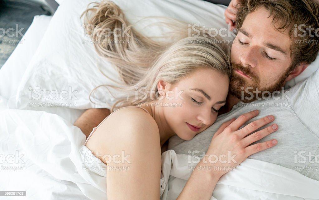 Loving couple sleeping together stock photo