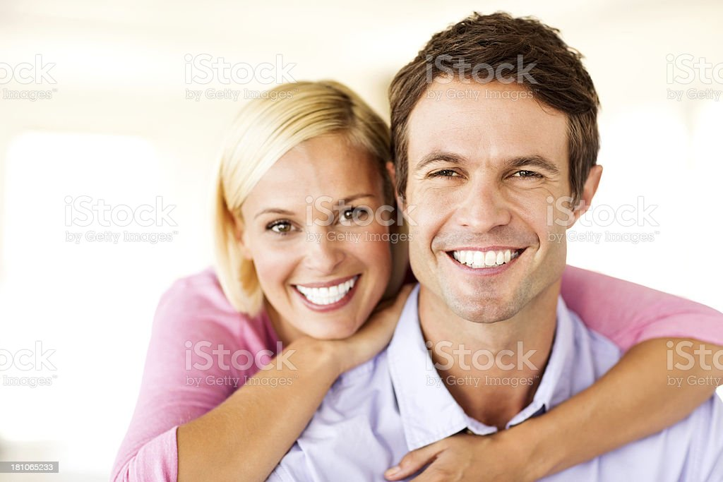 Loving Couple Smiling Together At Home stock photo