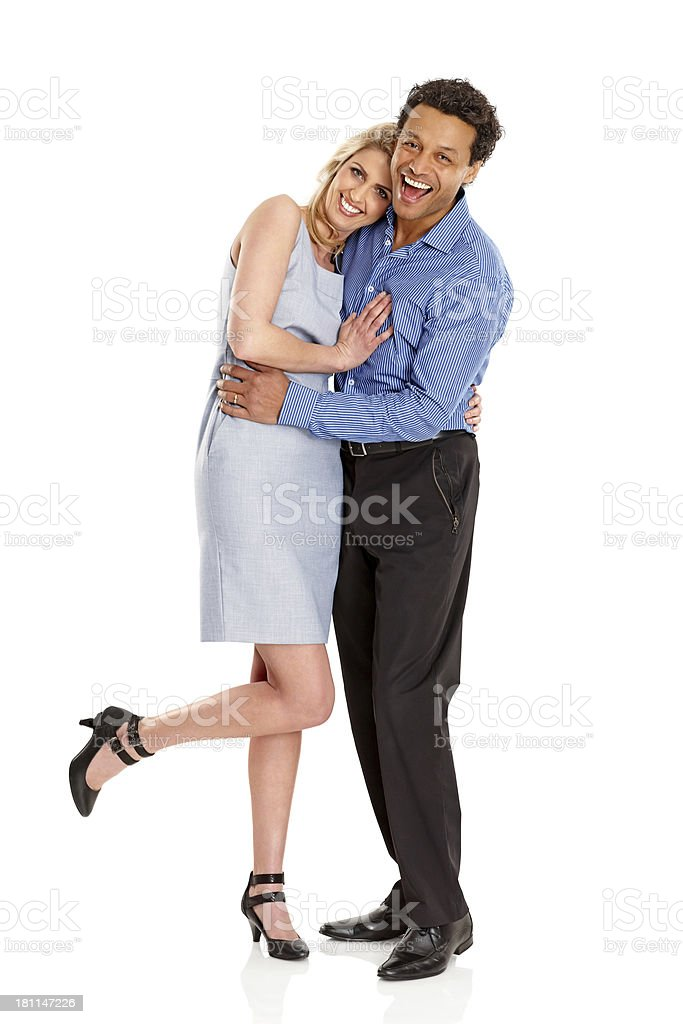 Loving couple standing together over white background royalty-free stock photo