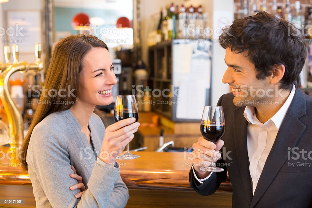 Loving couple takes a drink in restaurant stock photo