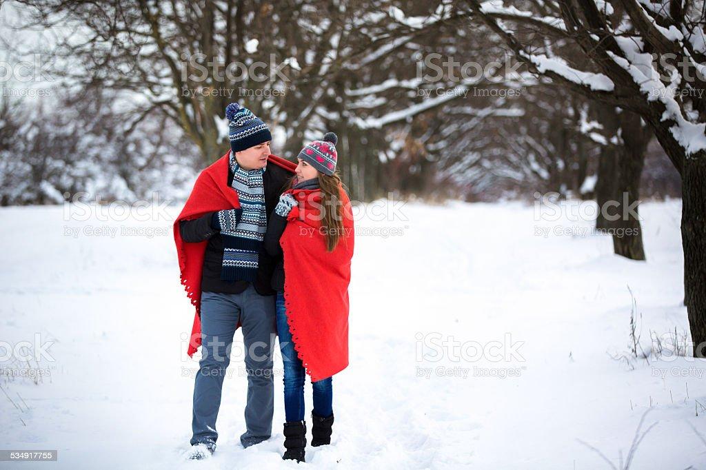 loving couple walking in winter park stock photo