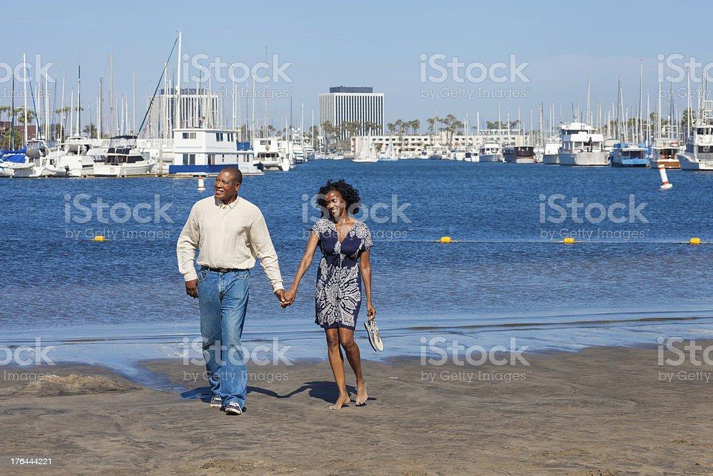 Loving couple walking on the beach royalty-free stock photo