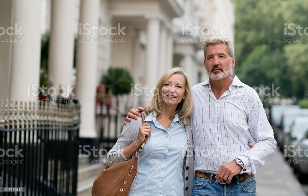 Loving couple walking on the street stock photo