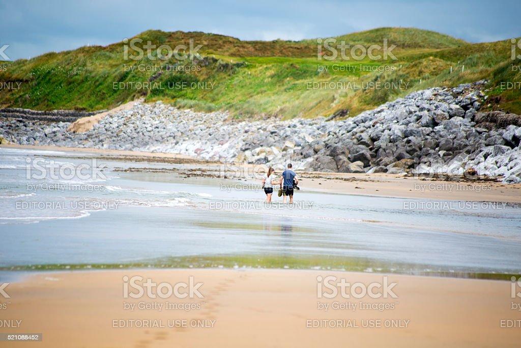 loving couple with dog paddeling stock photo