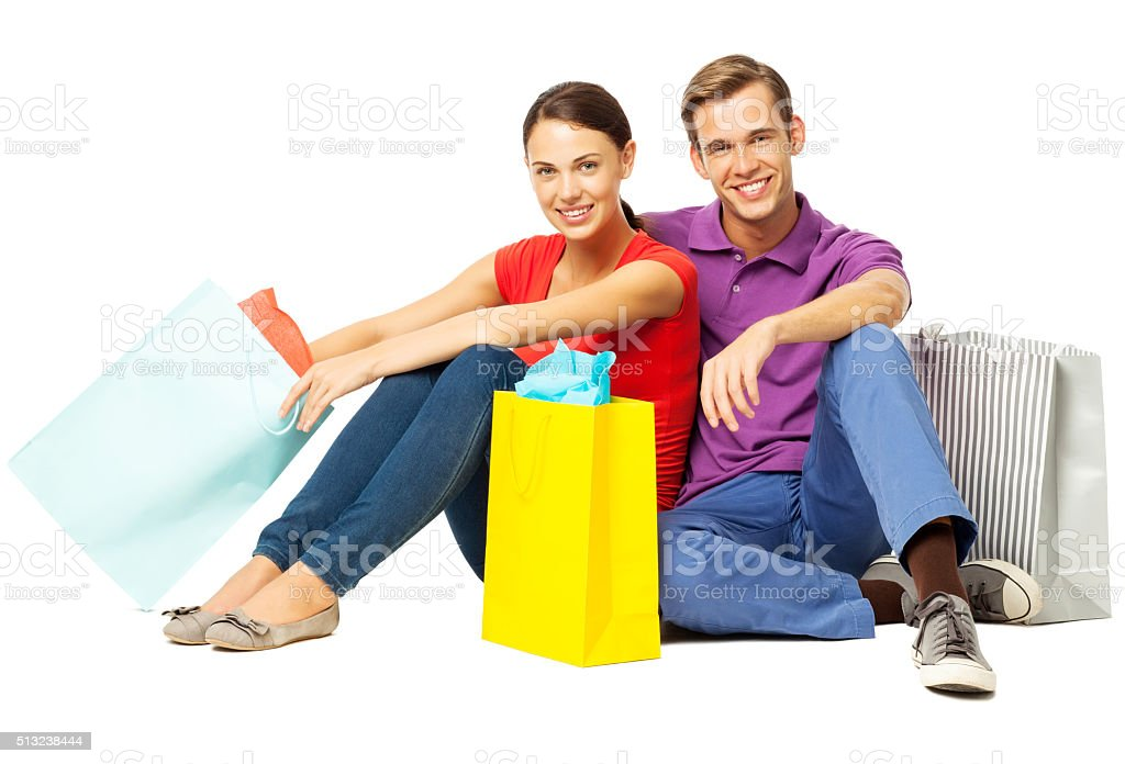Loving Couple With Shopping Bags Sitting On Floor stock photo