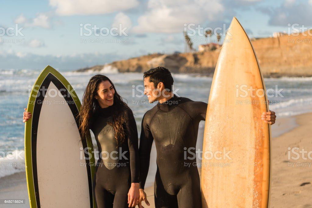 Loving Couple With Their Surboards stock photo