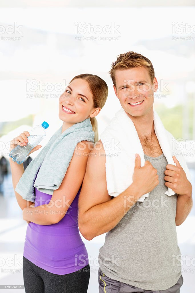 Loving Couple With Towels And Water Bottle In Gym royalty-free stock photo