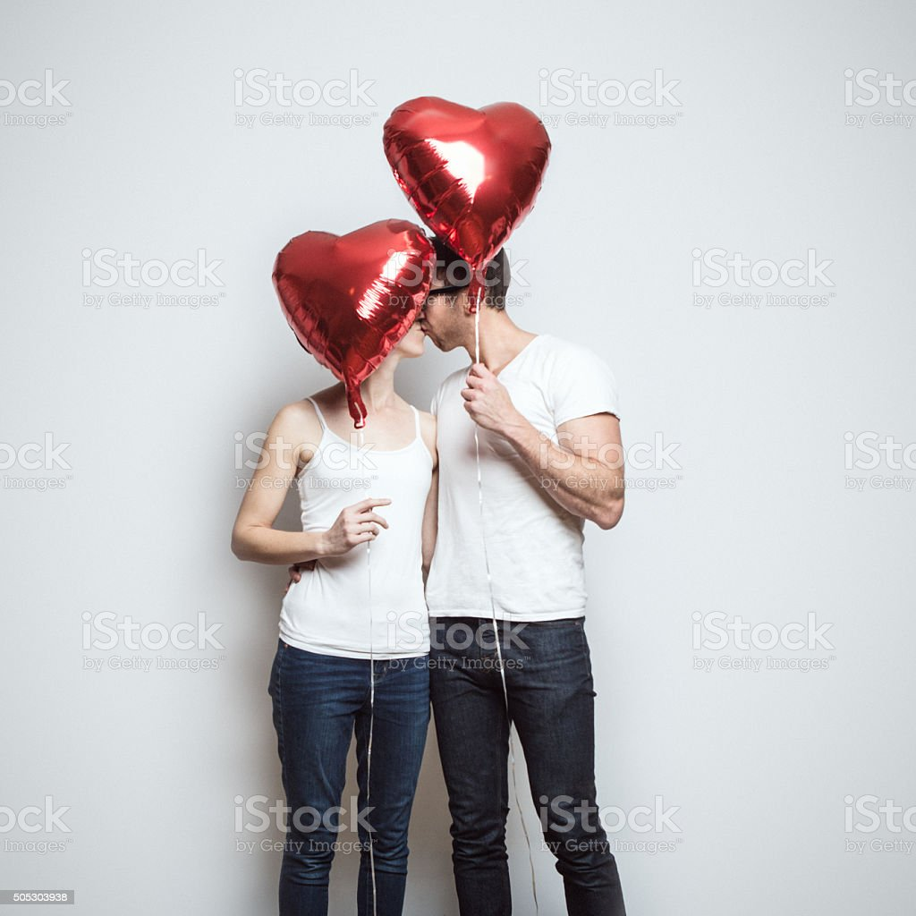 Loving Couple With Valentines Day Balloons stock photo