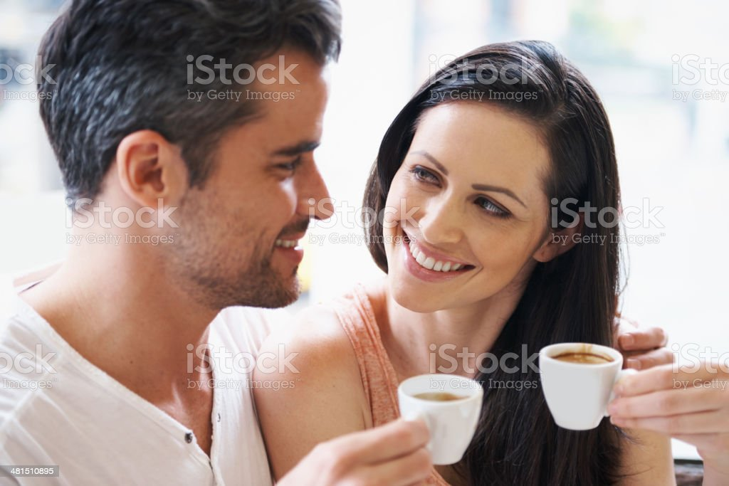 Loving expressions over their espresso stock photo