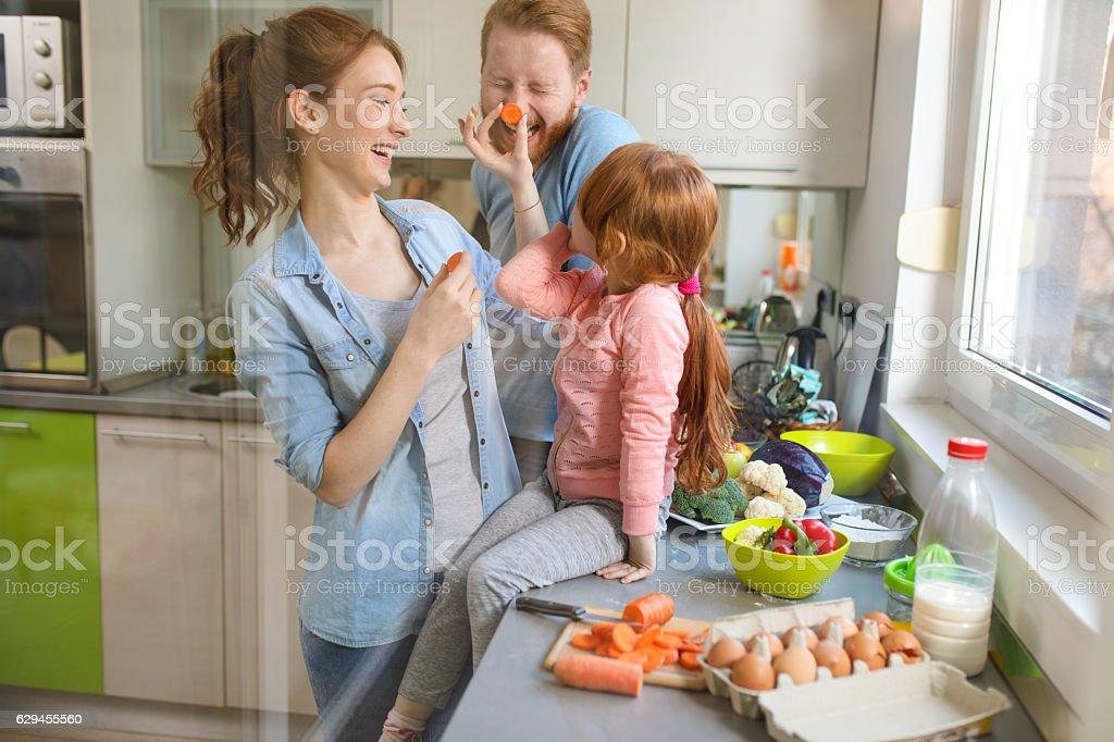Loving family having fun preparing food in the kitchen. stock photo