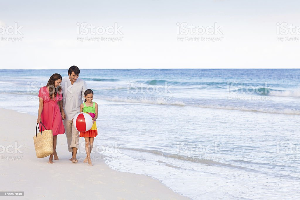 Loving family walking by the beach royalty-free stock photo