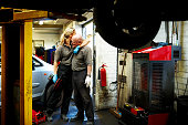 Loving father and daughter in their auto garage