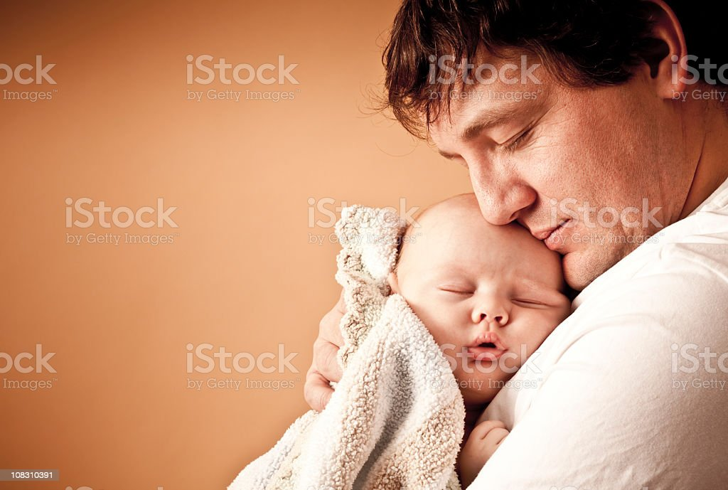 Loving father holding his newborn baby boy stock photo