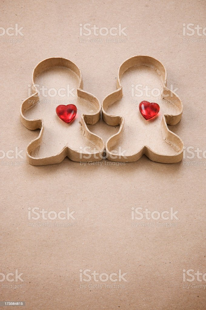 Loving Gingerbread Couple with Red Hearts stock photo