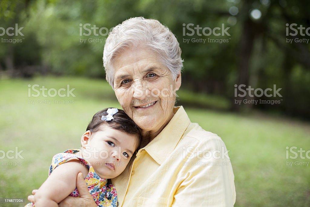 Loving grandmother holding her grandchild royalty-free stock photo