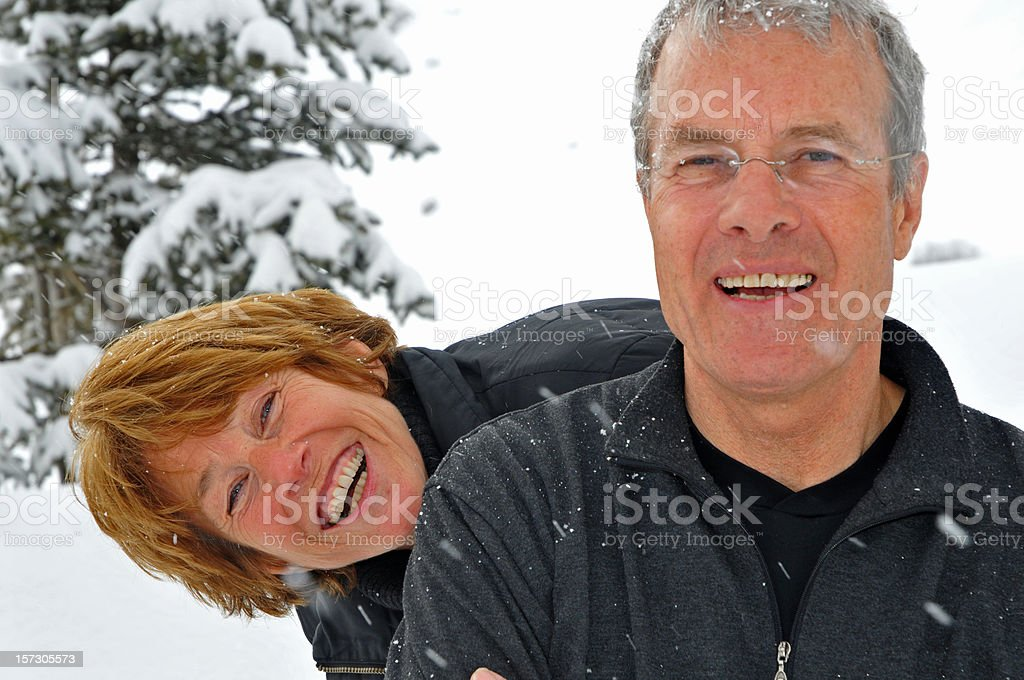 Loving happy senior couple in the snow royalty-free stock photo