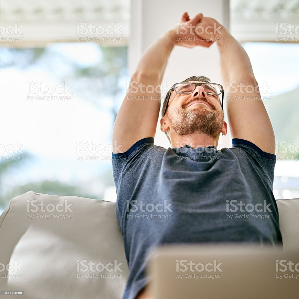 Loving his laid-back day at home stock photo