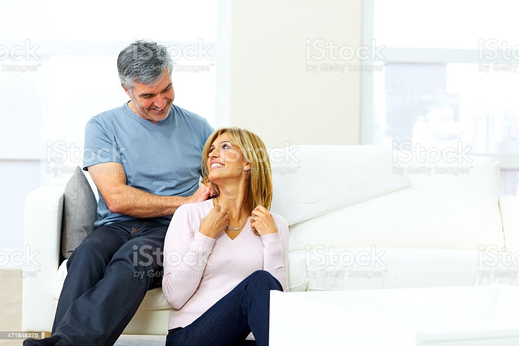Loving husband gifting necklace to his wife royalty-free stock photo
