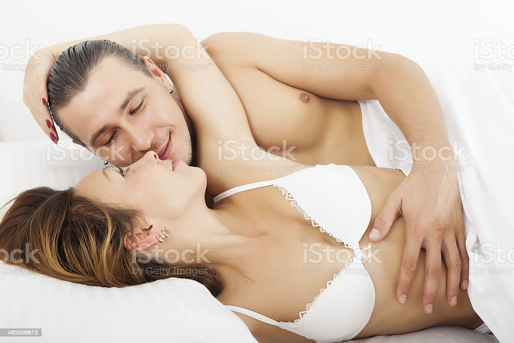 Loving man and woman awaking together stock photo