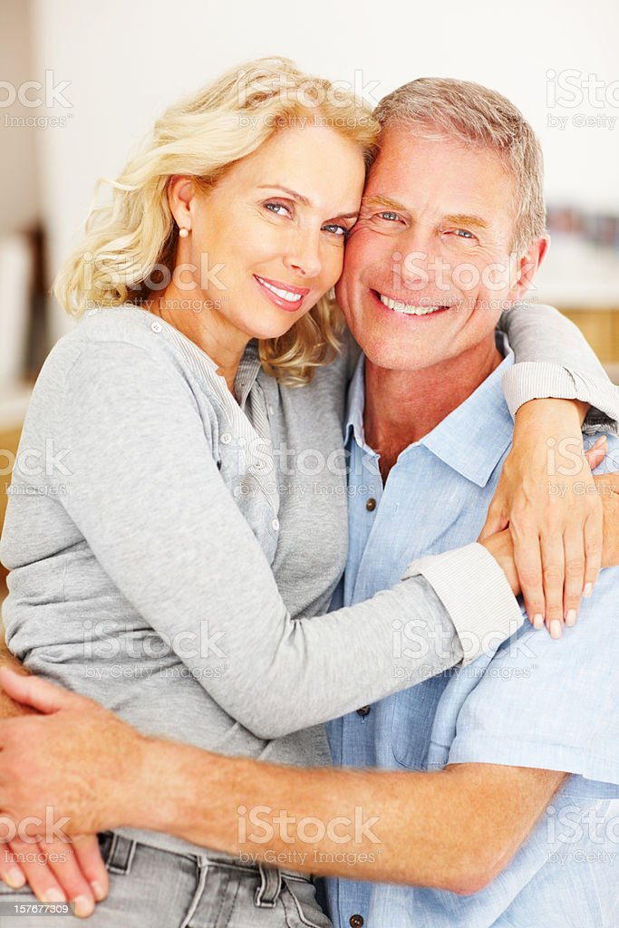 Loving mature couple embracing each other, smiling royalty-free stock photo